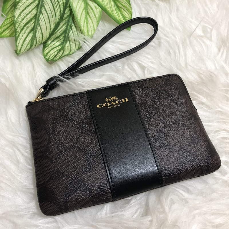 46145e4e92ec9 ... wholesale coach corner zip wristlet in signature coated canvas with  leather stripes im brown black f58035