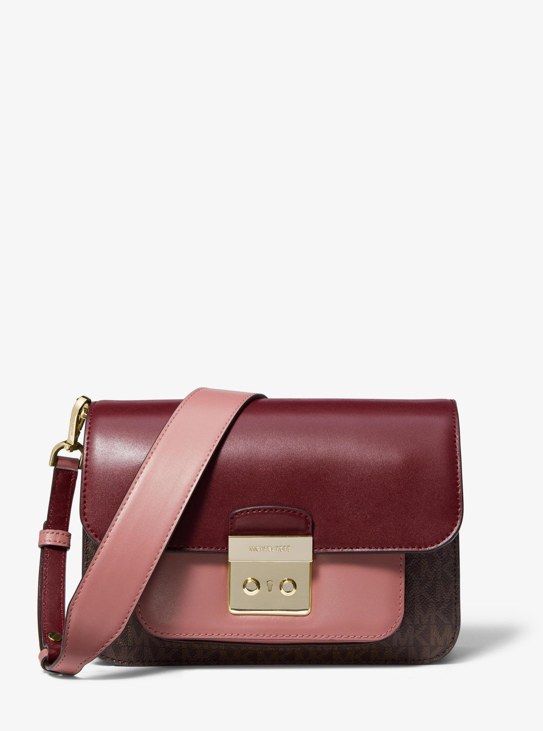 5f25e001b7a2 Home › Michael Kors Sloan Editor Logo and Leather Shoulder Bag. Low of  Stock 15423401429158759_2210X2975.jpg