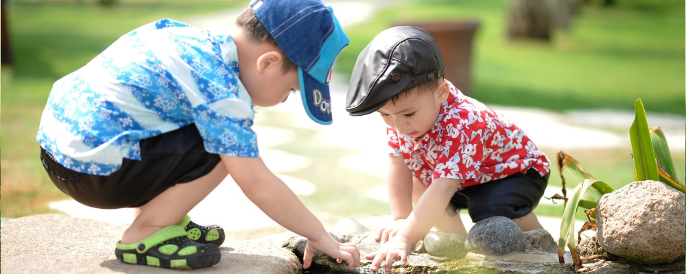 two young children playing together outdoors