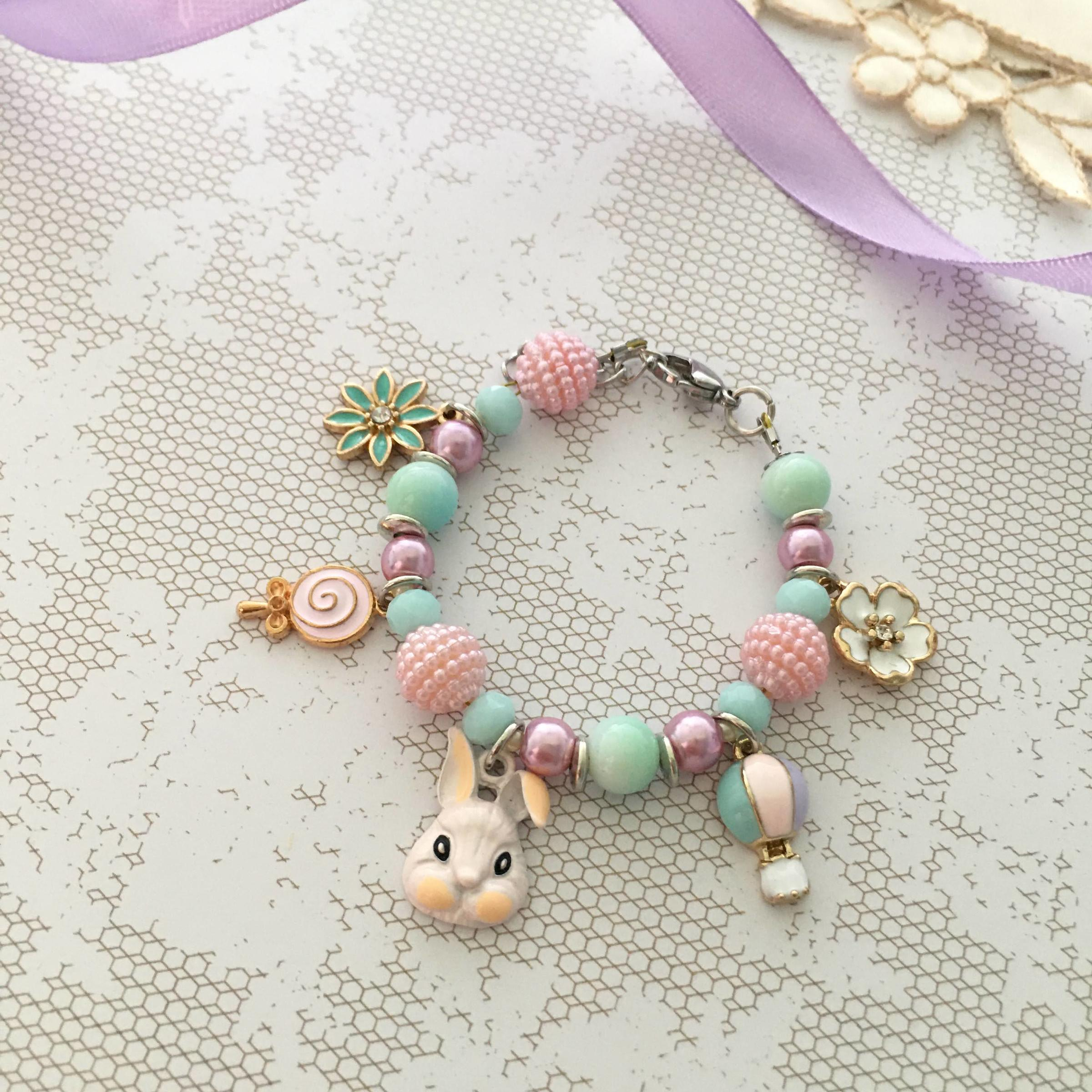 Cute bunny and lollipop charm bracelet.JPG