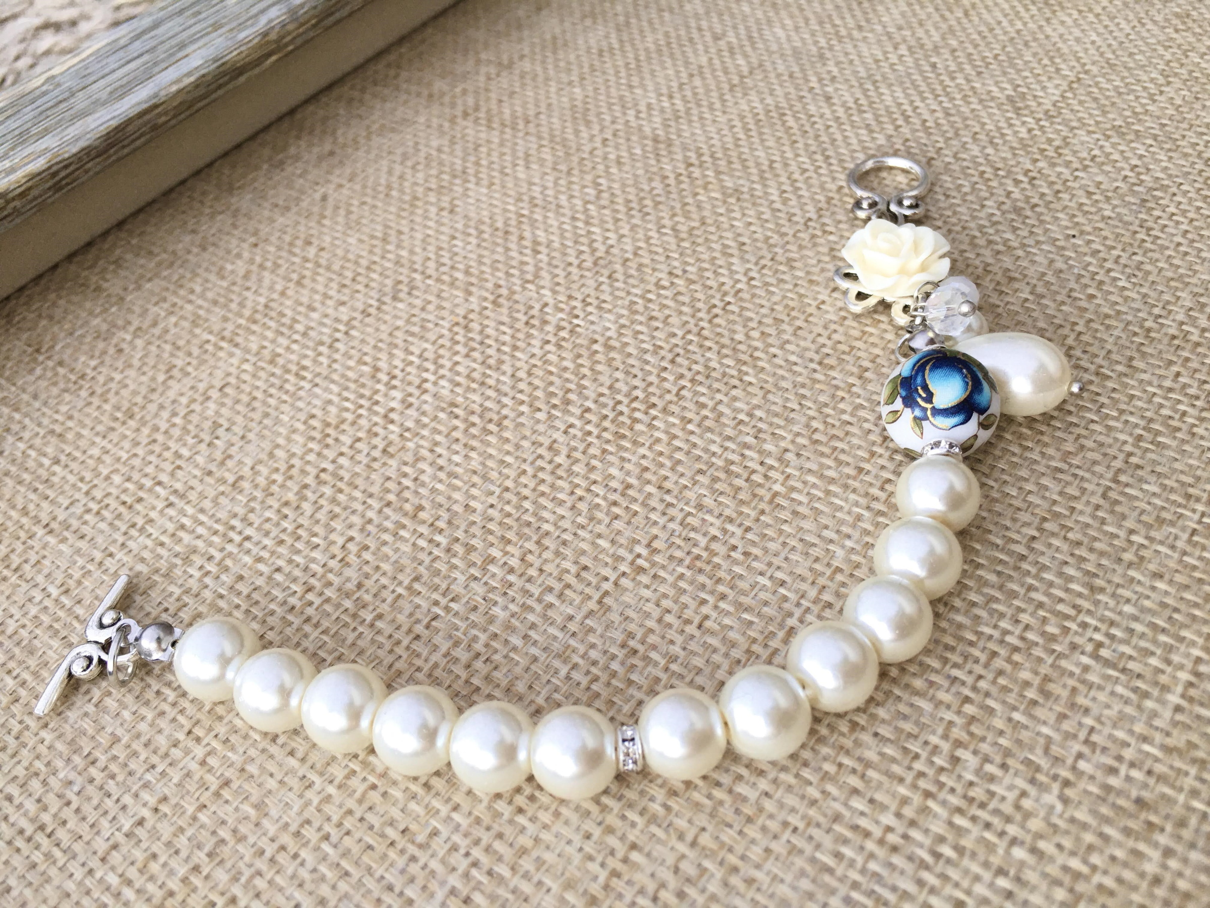 Classic White Elegant Pearl Bracelet with Tensha Floral Bead.JPG