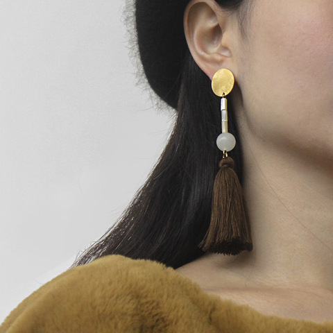 dense_tea_big_tassel_earrings_7.jpg