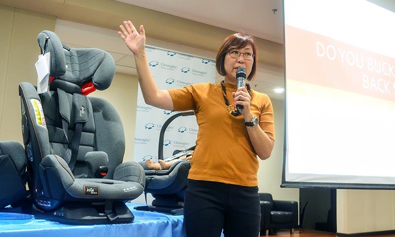 May Hwong conducting a Car Seat Safety talk