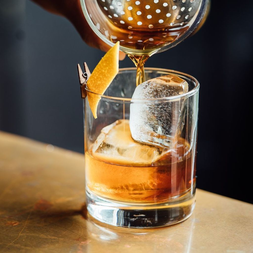 closeup-glass-with-alcohol-in-cocktail-bar-royalty-free-image-1581695686.jpg