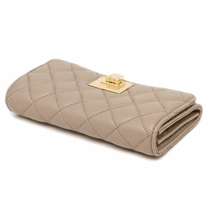 c4c68b107379a6 Michael Kors Astrid Quilted Leather Large Carryall Clutch In DK Taupe