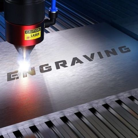 metal-processing-with-sparks-in-a-cnc-laser-engraving-machine-740x450-1.jpg