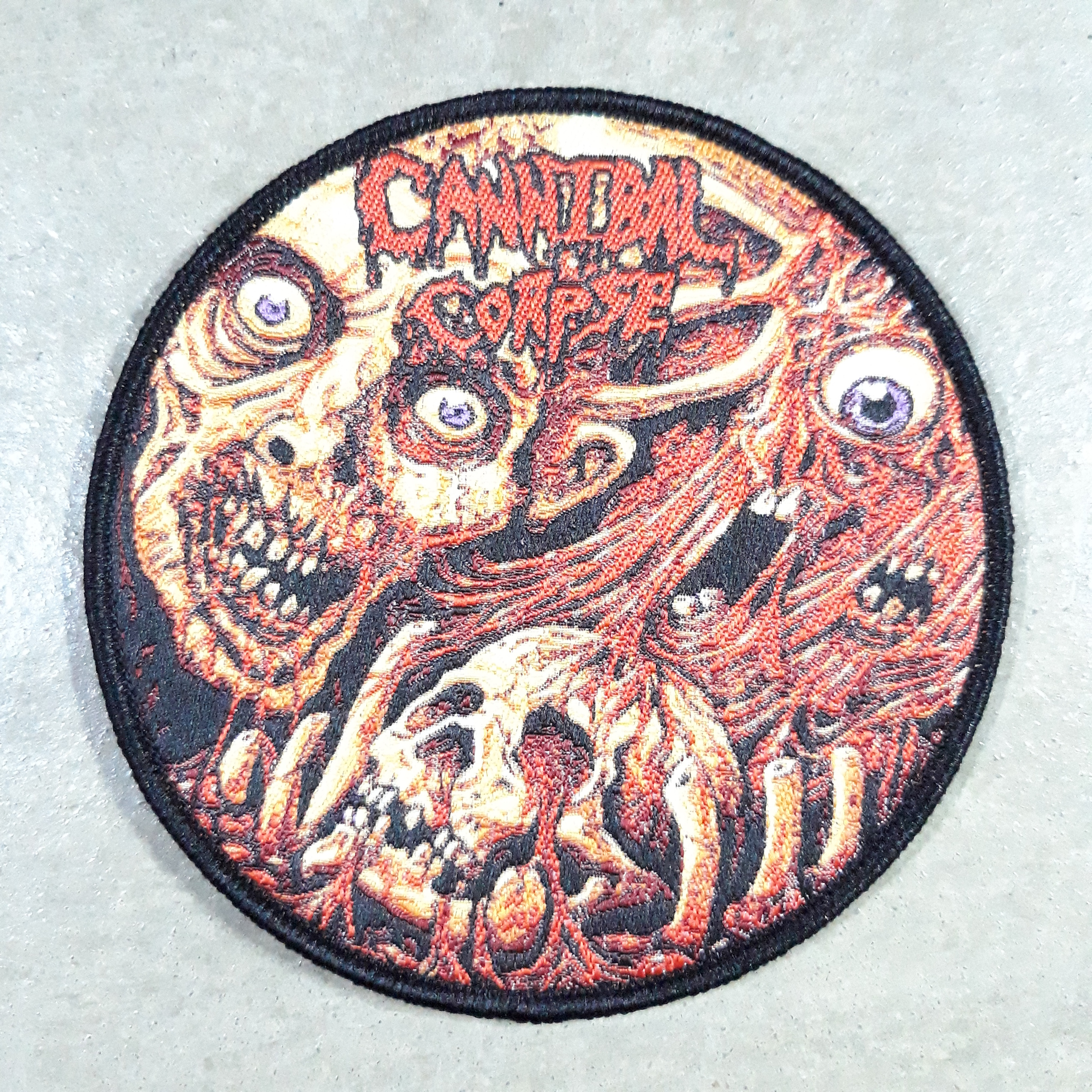 Cannibal corpse round woven patch.jpg