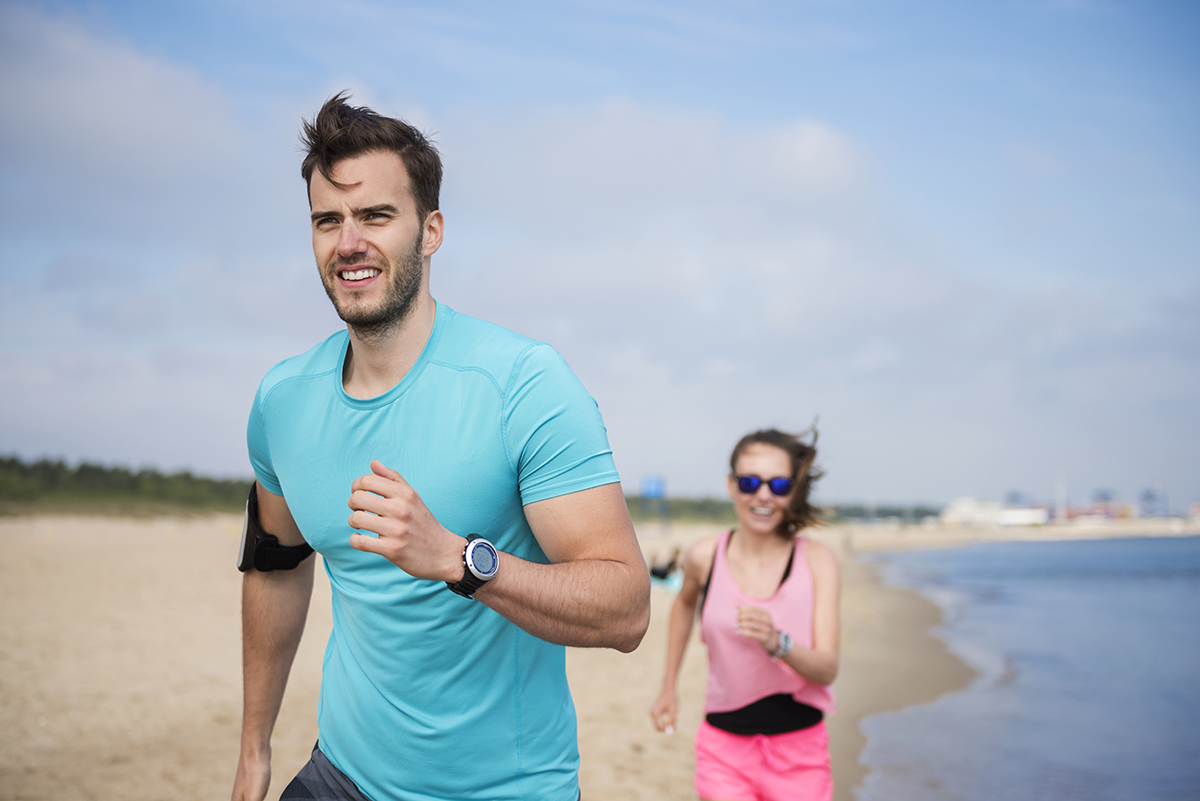 man-and-female-morning-cardio-on-the-beach