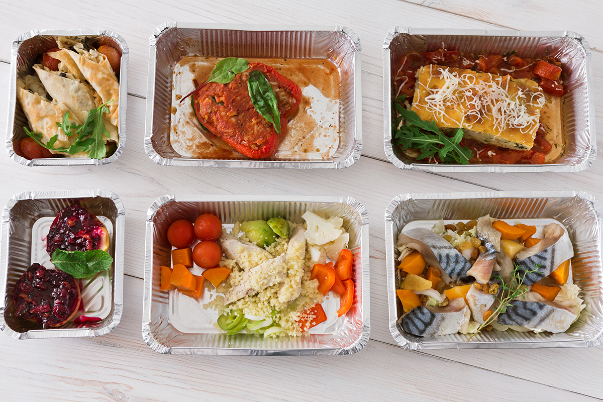 protein-carbs-food-take-away-in-boxes-top-view-on-wood