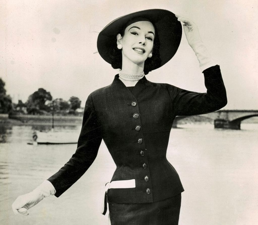 June-modelling-a-tailored-wool-suit-holding-the-brim-of-her-picture-hat-about-1951-52-location-and-photographer-unknown-2.jpg