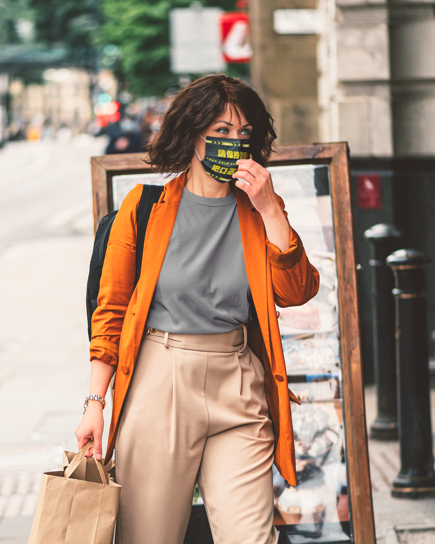 t-shirt-and-face-mask-mockup-of-a-stylish-woman-walking-down-the-street-45429-r-el2.png