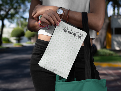 mockup-of-a-young-woman-carrying-a-cosmetic-pouch-on-the-street-29975 (5).png