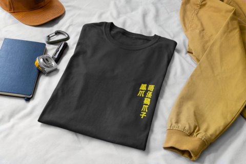 mockup-of-a-folded-t-shirt-on-a-bed-with-some-working-tools-33921 (1).png
