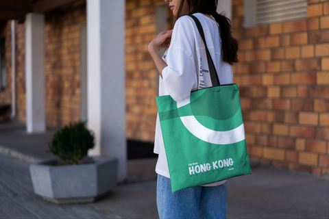 mockup-of-a-woman-with-a-tote-bag-walking-on-a-hallway-3133-el1 (14).png