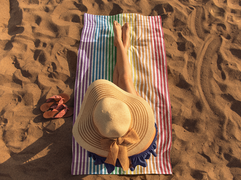 girl-sunbathing-on-a-beach-towel-template-a14887 (1).png