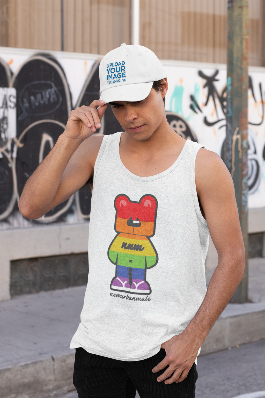 mockup-of-a-man-wearing-a-tank-top-while-holding-his-dad-hat-31168.png