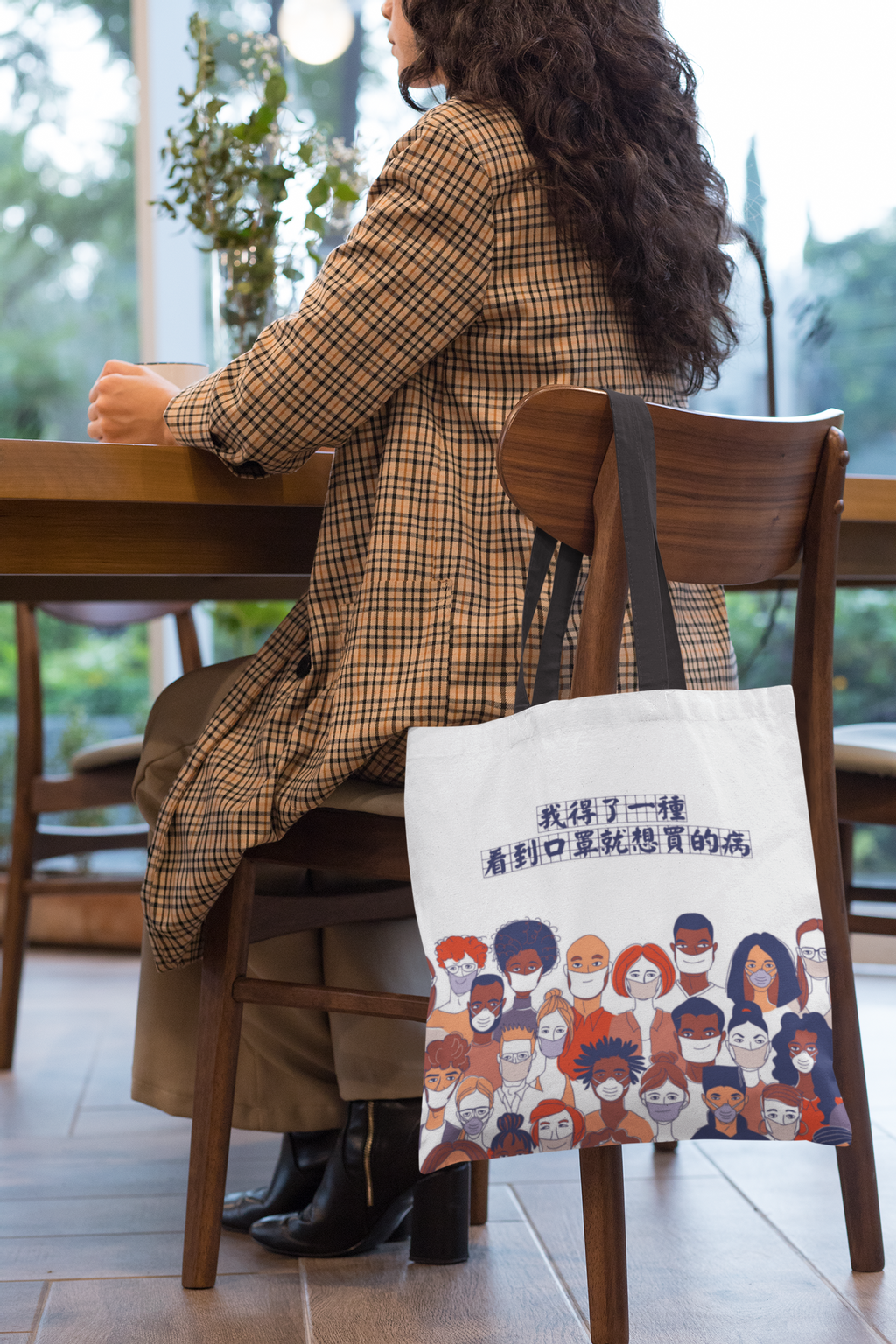 tote-bag-mockup-of-a-woman-sitting-on-a-chair-29457.png