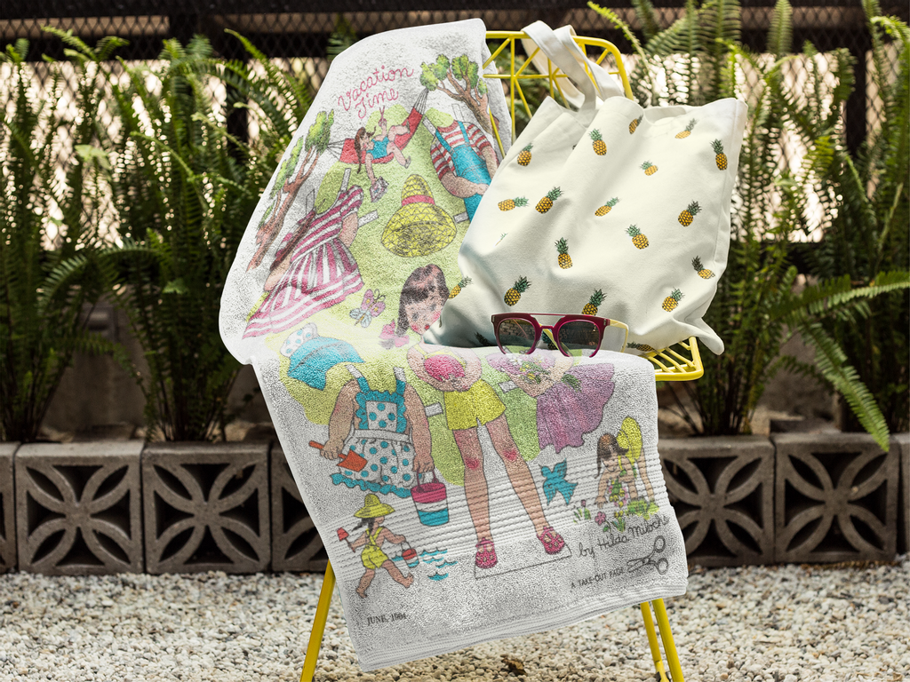 towel-mockup-on-a-chair-with-a-pineapple-printed-bag-and-sunglasses-lying-on-it-a14899 (8).png