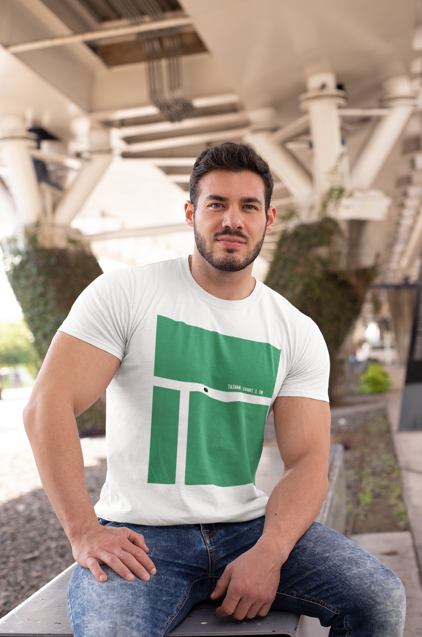t-shirt-mockup-of-a-muscular-man-sitting-on-a-bench-in-the-city-28516.png