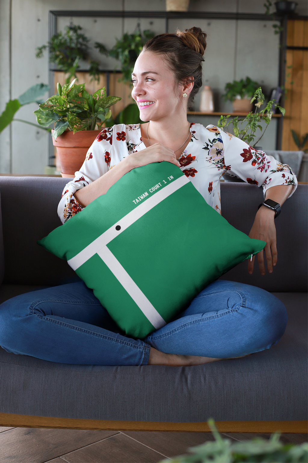mockup-of-a-smiling-woman-holding-a-pillow-at-a-lounge-23611.png