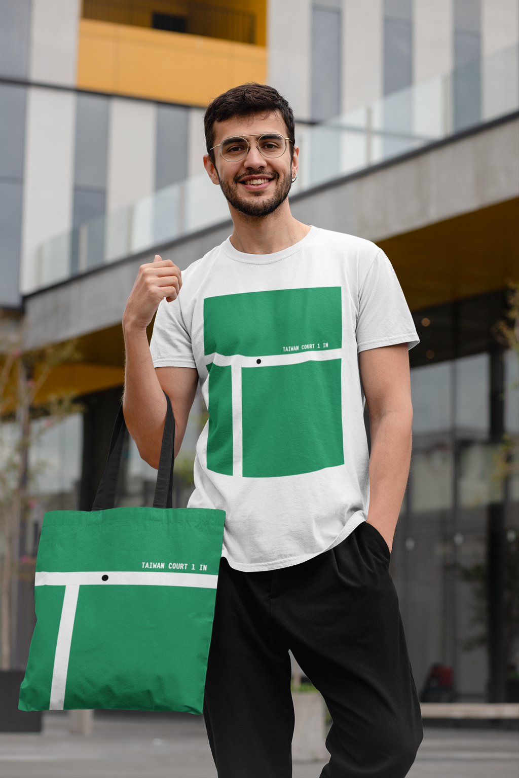 mockup-of-a-trendy-man-wearing-a-t-shirt-and-carrying-a-tote-bag-29410 (1).png