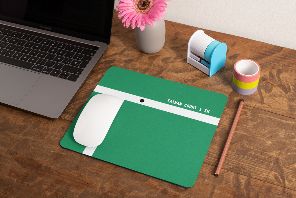 mockup-of-a-mousepad-lying-on-a-rustic-table-next-to-a-flower-vase-27554.png