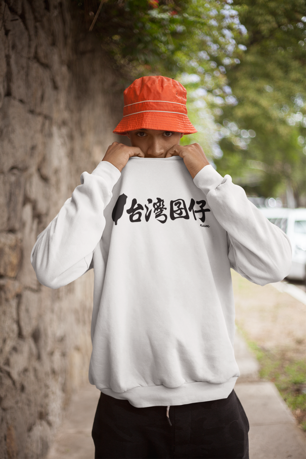 sweatshirt-mockup-of-a-man-covering-his-face-by-a-stone-wall-21068.png