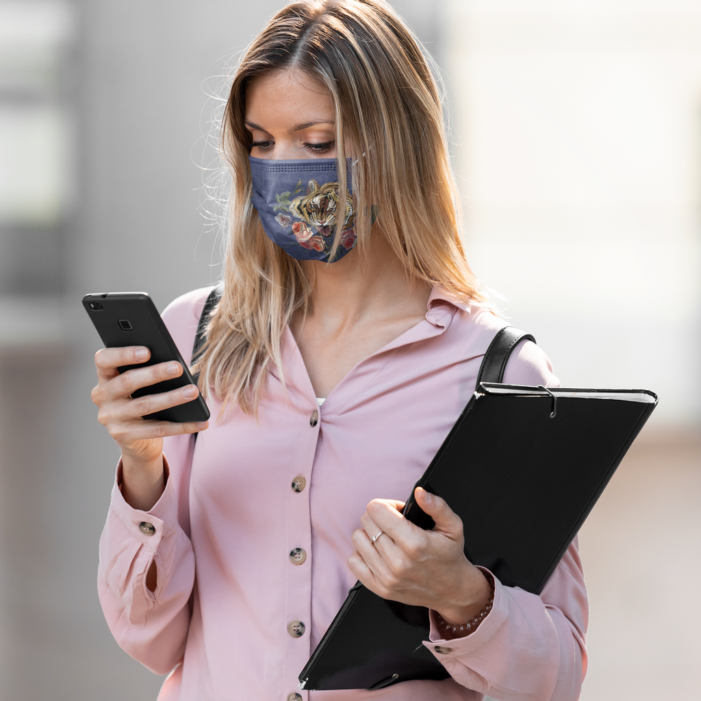 face-mask-mockup-of-a-woman-working-while-checking-up-her-phone-41947-r-el2.png