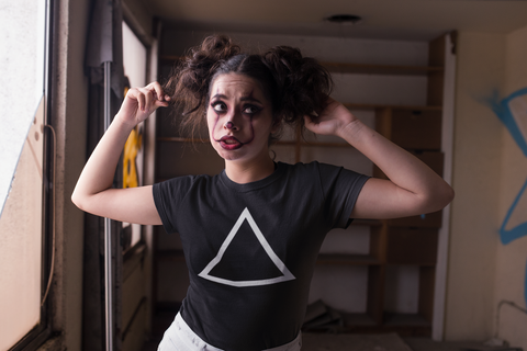 t-shirt-mockup-of-a-woman-with-clown-make-up-for-halloween-22936 (1).png