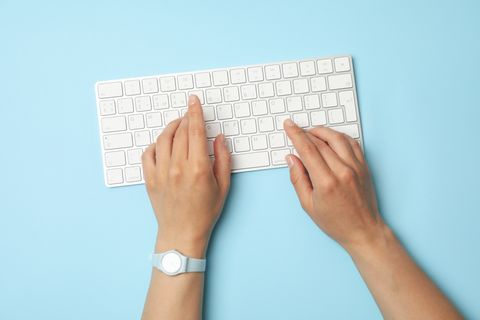 female-hands-with-clock-are-typing-keyboard-blue.jpeg