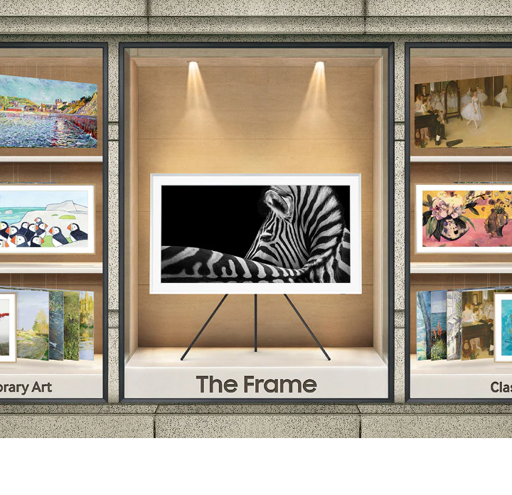The Frame is being showcased between various artwork pieces.