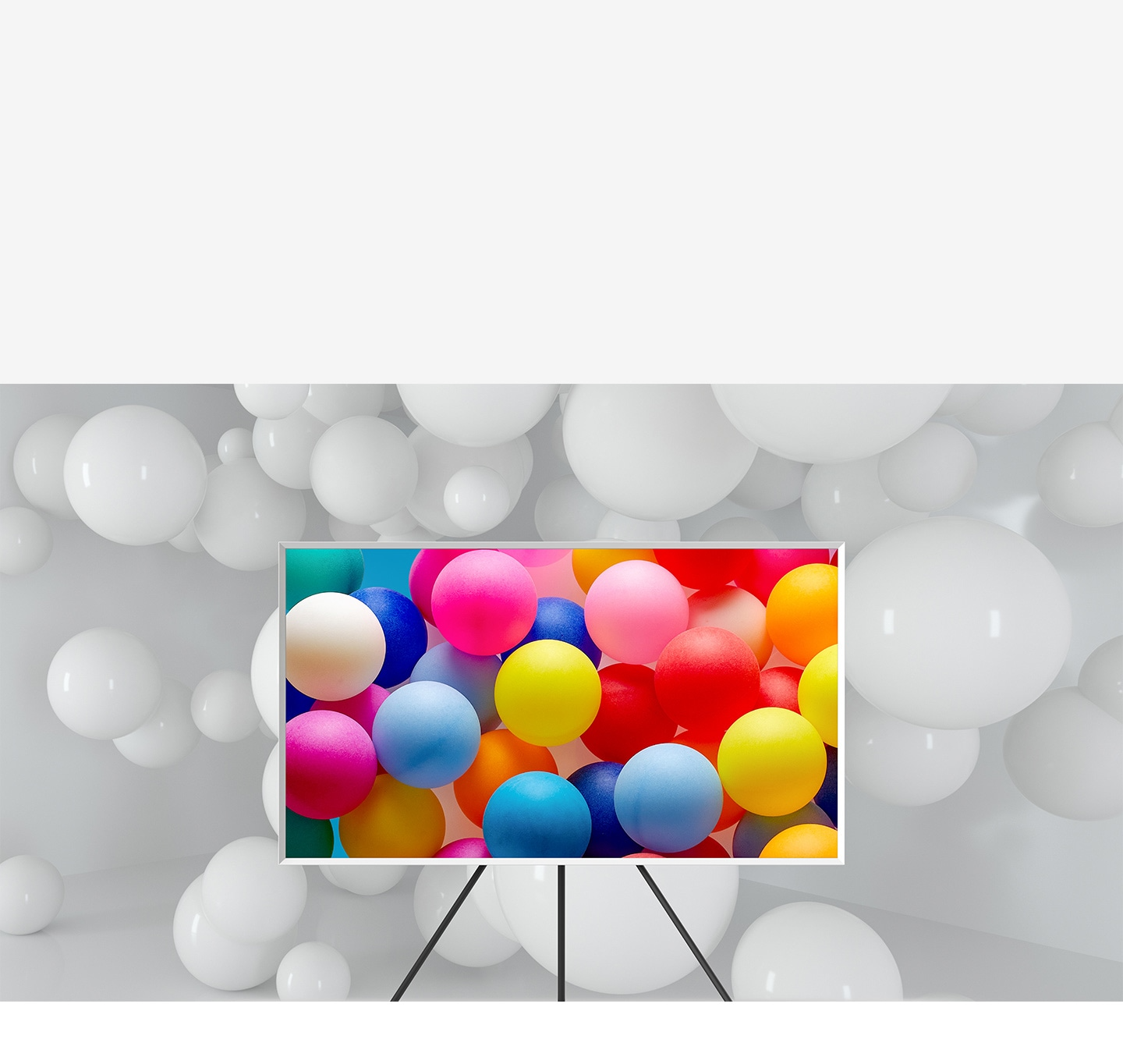 The Frame which is on Studio Stand is in a room full of white balloons. Only the balloons on the screen are visible in various vivid colours.