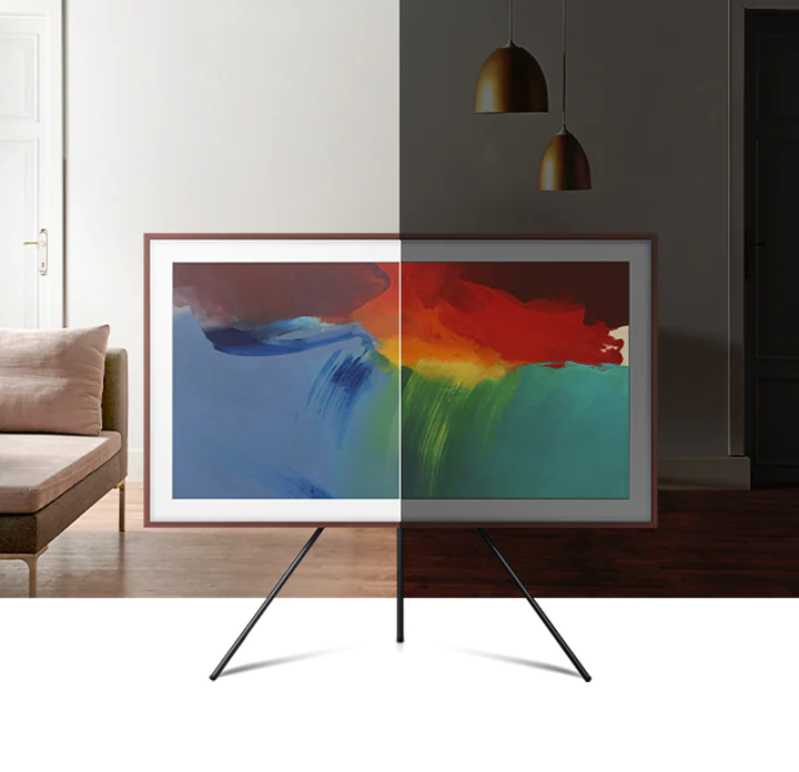 The effect of The Frame's brightness sensor is shown. On the left side, brightness levels of the on-screen artwork matches the brightness level of living room. On the right side, the brightness levels of the image is lowered to match the low-light setting of living room.