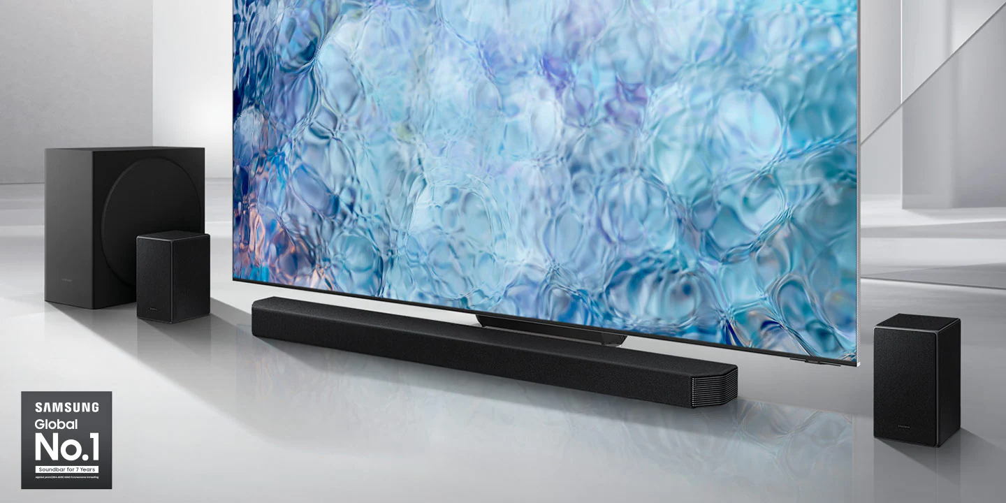 Samsung Global No.1 logo can be seen along with Samsung Q950A Soundbar, subwoofer and rear speakers which are positioned next to QLED TV.