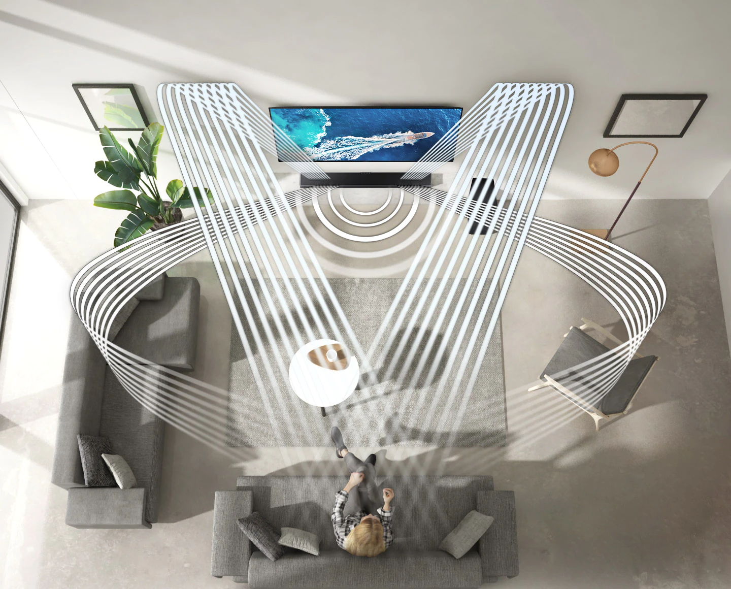 Various soundwave graphics coming from soundbar illustrate how the woman enjoying QLED TV in her living room experiences sound created by Samsung Acoustic Beam. 2 soundwave graphics are up-firing from the top of the soundbar and toward the woman. 3 soundwave graphics are coming from the side and center of the soundbar and toward the woman.