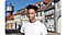 High quality portrait shot of a young man looking up, while the houses with many windows blurred out in the background.