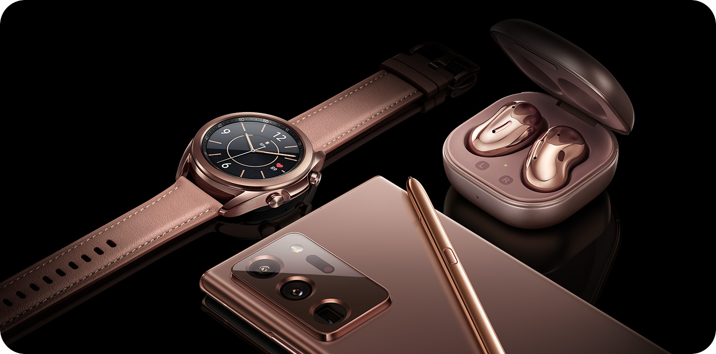 Description: Front view of Galaxy Watch3 next to Galaxy Buds Live and rear view of Galaxy Note20.