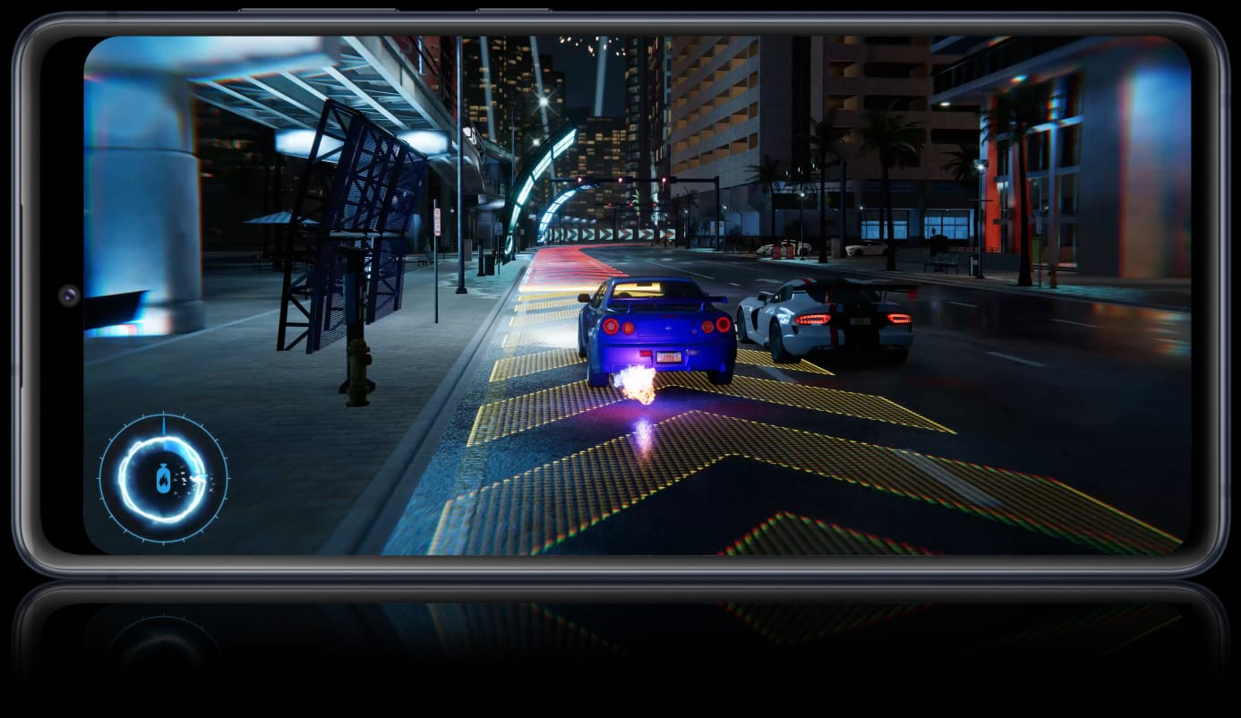 Description: Galaxy S20 FE with a scene from Forza Horizon 4 onscreen showing the detail you can experience in your games with 5G speeds.
