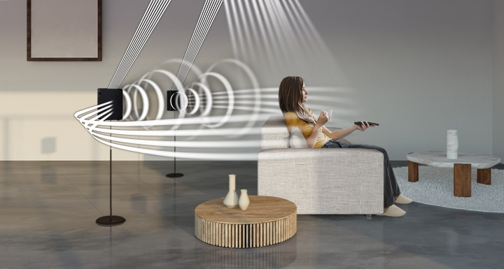 A woman enjoys TV. Soundwave graphics demonstrate Q950A wireless rear speaker's upfiring capability in addition to normal sound output direction.