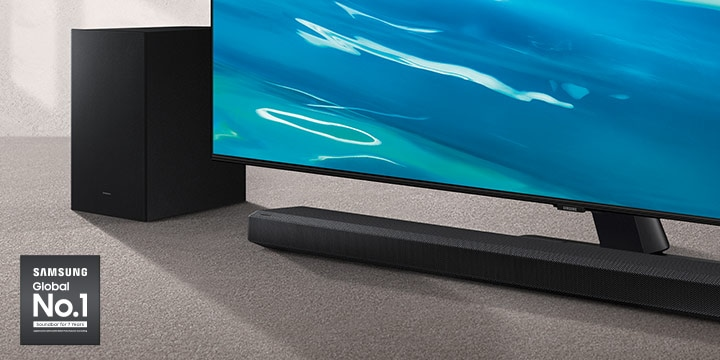 Samsung Global No.1 logo can be seen along with Samsung Q700A Soundbar and subwoofer which are positioned next to QLED TV.