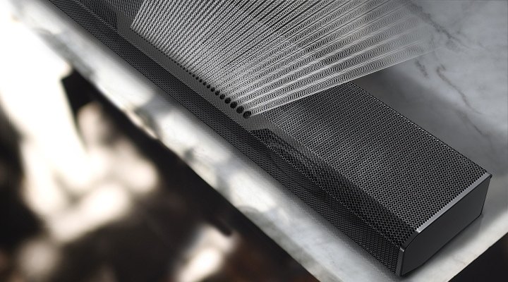 Precisely spaced soundwave graphics are coming out from the top of Q800A Soundbar, illustrating Samsung Acoustic Beam technology.