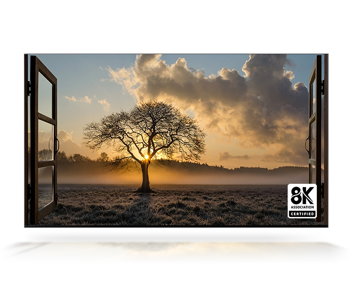 The sun sets out the window and there is a thin tree in a wide field. QLED 8K TV is certified by the 8K Association.