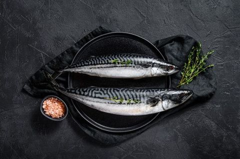 Raw Mackerel Fish With Thyme And Pink Salt_ Fresh Seafood. Black Background. Top View.Space For Text.jpeg