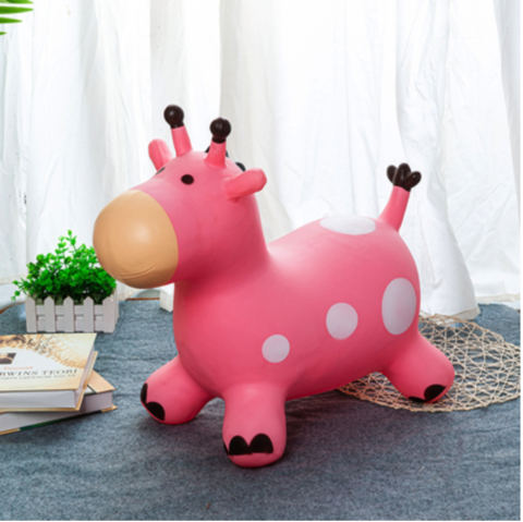 23 BOUNCING GIRAFFE WITH MUSIC - PINK.png