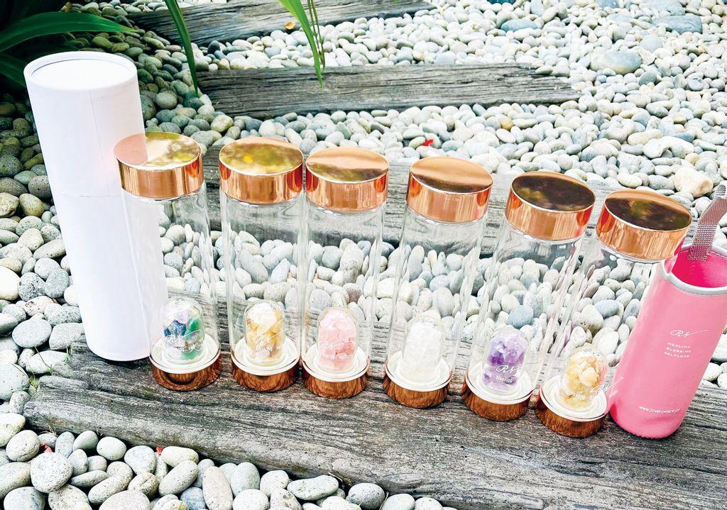 crystal stones bottles full.jpg