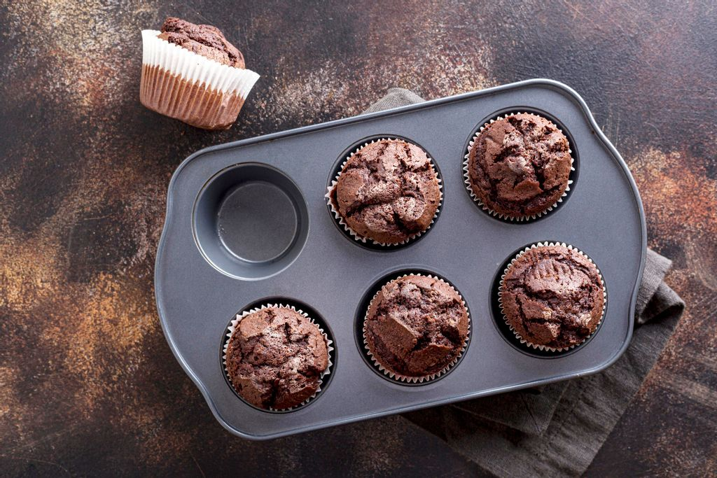 top-view-chocolate-muffins-tray-with-cloth.jpg