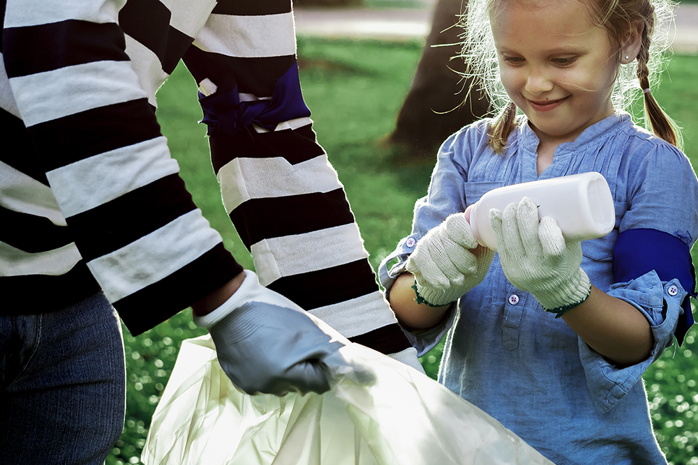 plastic-pollution-awareness-with-girl-sorting-garbage.jpg