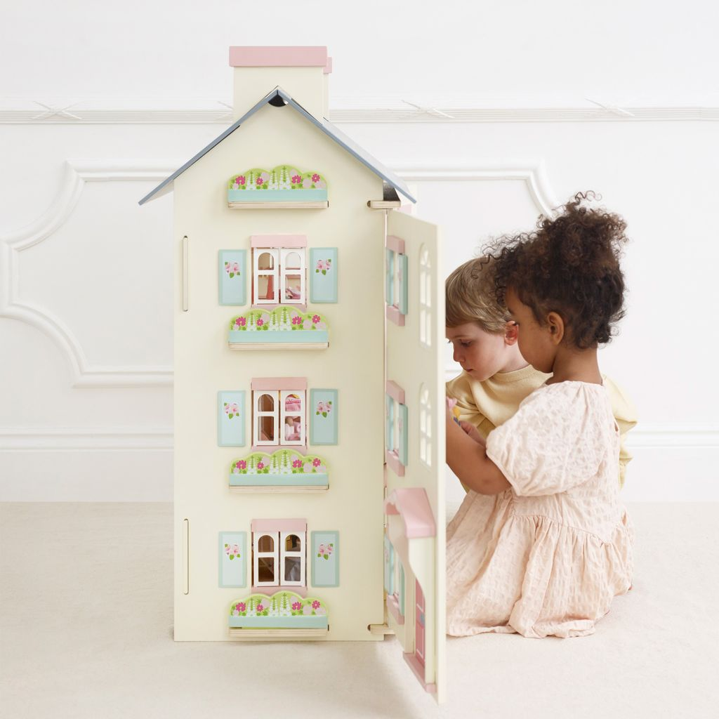H150-cherry-tree-hall-2021-boy-girl-playing-with-dolls-house-door-open.jpg