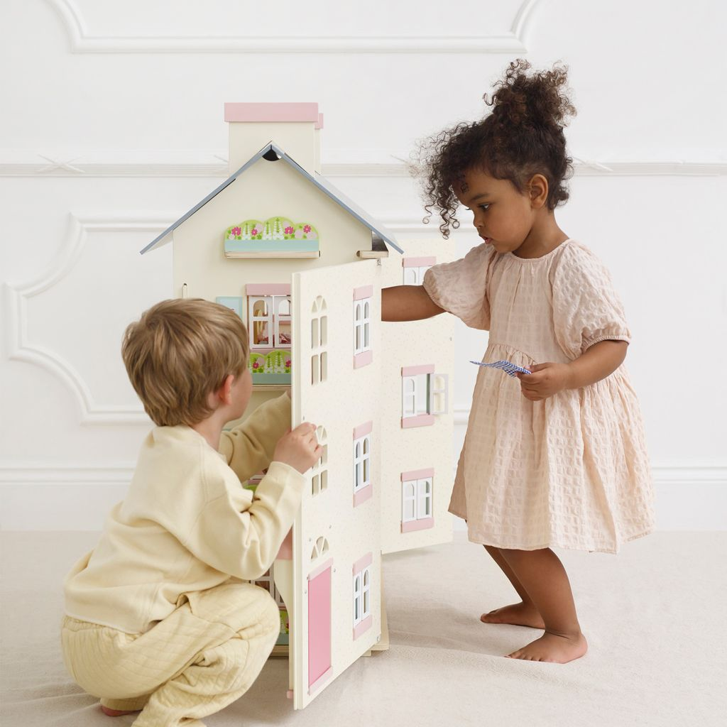 H150-cherry-tree-hall-2021-girl-boy-playing-with-dolls-house-together.jpg